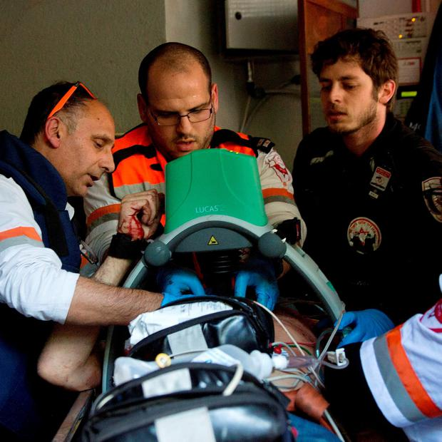 Israeli medics tend to a wounded person at the scene of a shooting attack in Tel Aviv, Israel. (AP Photo/Oded Balilty)