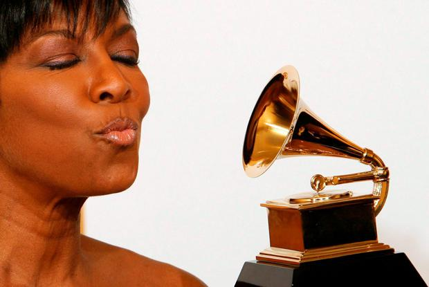 Natalie Cole poses backstage after winning Best Traditional Pop Vocal Album for