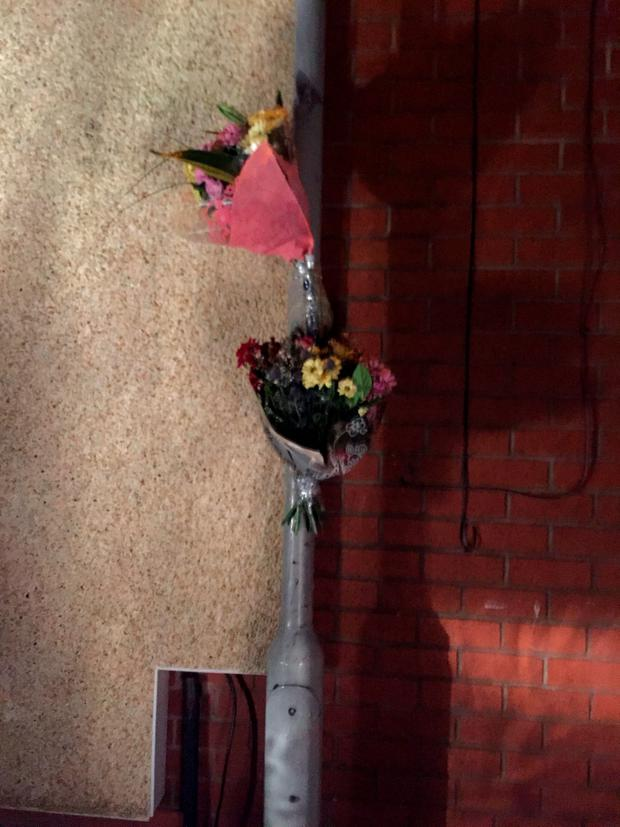 Flowers near the scene in Dundonald Street in Preston, Lancashire, where a 22 year old man was bitten and killed by a dog Credit: Lauren Brown/PA Wire