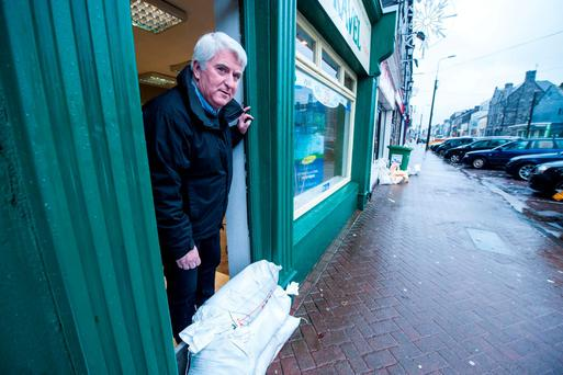 Declan O'Connell of Lee Travel in his Midleton shop as the clean up continues after the flooding this week. Photo: Provision