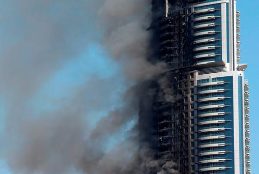 The Address Downtown Dubai hotel was still smouldering yesterday after flames engulfed the luxury tower block. Photo: Getty