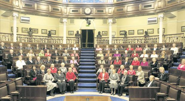 Some of the women elected to Leinster House posing in a picture organised by Ivana Bacik in 2008