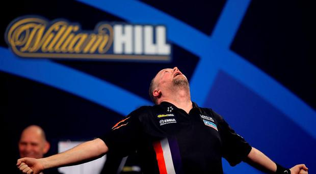 Raymond van Barneveld celebrates winning against Michael Smith in the Quarter Finals matches during day thirteen of the William Hill PDC World Championship at Alexandra Palace, London.