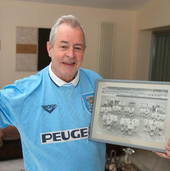 Former Coventry player Rory Linnie (66), holding a photograph of him with his Coventry teammates. Photo: Damien Eagers