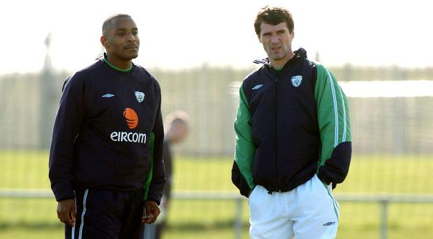 Republic of Ireland team-mates Clinton Morrison, left, and Roy Keane in conversation during squad training in 2005