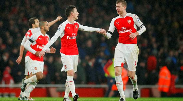 Laurent Koscielny celebrates with Per Mertesacker after scoring the first goal for Arsenal