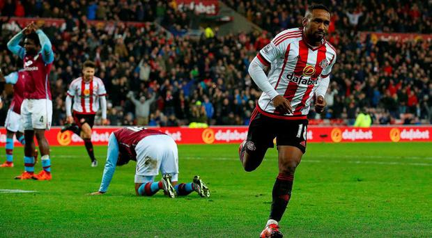 Sunderland's English striker Jermain Defoe (R) celebrates scoring his team's second goal