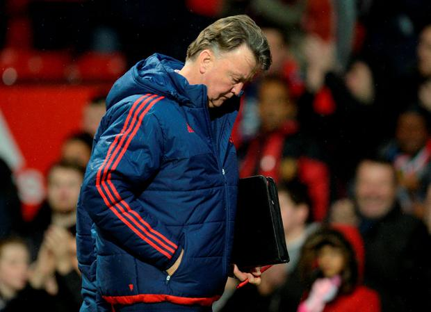 Manchester United's Dutch manager Louis van Gaal leaves after win