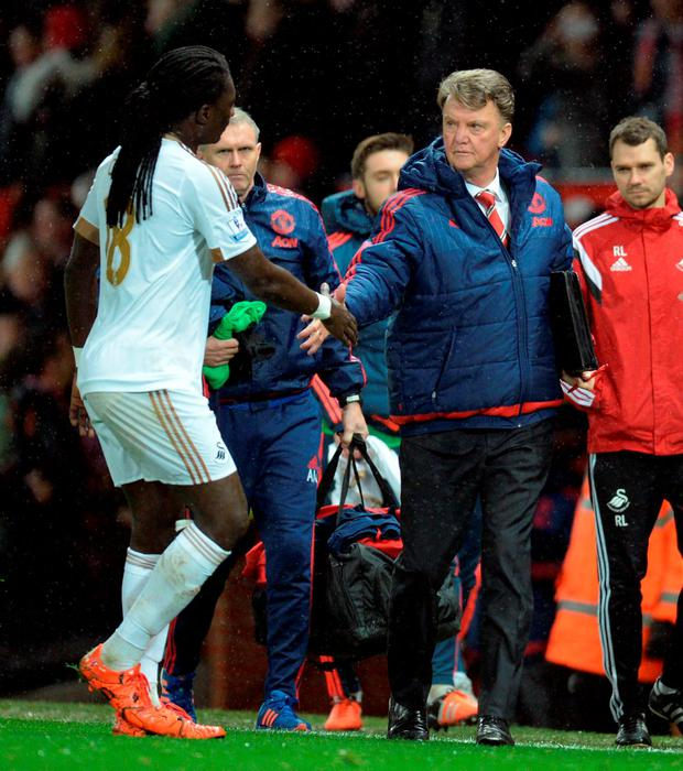 Manchester United's Dutch manager Louis van Gaal shakes hands with Swansea City's French striker Bafetimbi Gomis