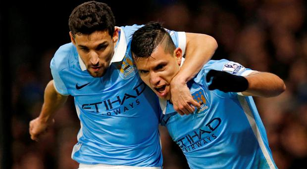 Sergio Aguero celebrates with Jesus Navas after scoring the second goal