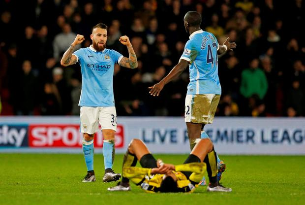 Manchester City's Yaya Toure and Nicolas Otamendi celebrate after the game