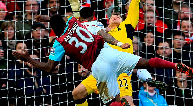West Ham's Michail Antonio scores his side's first goal at Upton Park yesterday. Photo: Adam Davy/PA Wire