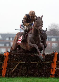Yorkhill, ridden by Ruby Walsh, pulls away from the last flight before going on to win the 32Red Tolworth Novices' Hurdle yesterday. Picture: Julian Herbert/PA Wire