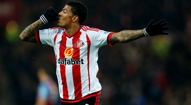 Sunderland's Patrick Van Aanholt celebrates scoring his side's first goal of the game during the Barclays Premier League match at the Stadium of Light, Sunderland. PRESS ASSOCIATION Photo. Picture date: Saturday January 2, 2016. See PA story SOCCER Sunderland. Photo credit should read: Owen Humphreys/PA Wire. RESTRICTIONS: EDITORIAL USE ONLY No use with unauthorised audio, video, data, fixture lists, club/league logos or