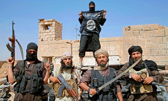 BARBARIC: Isil fighters in Syria armed with swords. Photo: Medyan Dairieh. Photo: Medyan Dairieh/ZUMA Press/Corbis