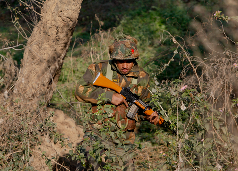 n Indian army soldier is seen during a search operation in a forest area outside the Pathankot air force base in Pathankot, India. (AP Photo/Channi Anand)