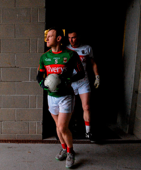 Mayo captain Colm Boyle leads the team out for the FBD Connacht League game against NUIG at MacHale Park yesterday Photo: David Maher / SPORTSFILE