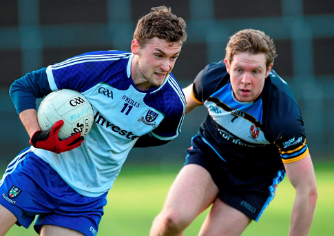Monaghan's Christopher McKenna tries to evade Ulster University's Frank Burns Photo: Philip Fitzpatrick / SPORTSFILE