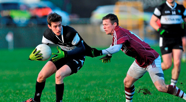 Galway's Danny Cummins tries to catch Sligo's Michael Gordon Photo: Ray Ryan / SPORTSFILE