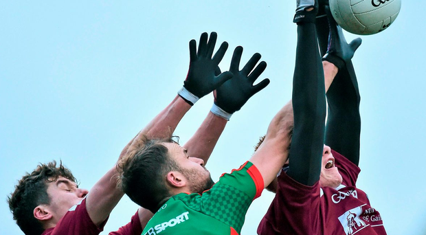 Mayo's Jason Gibbons up against Michael Daly (left) and Peter Cooke of NUIG Photo: David Maher / SPORTSFILE