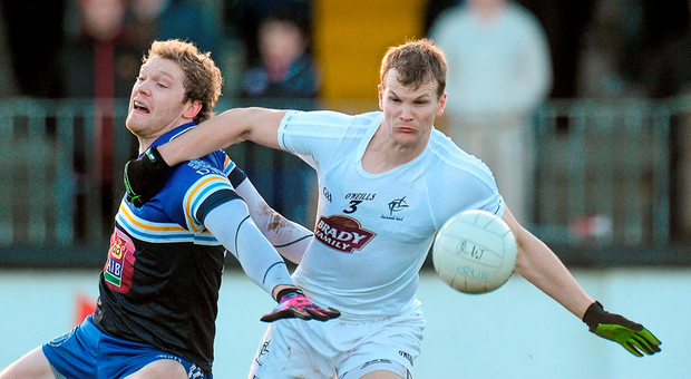 Kildare's Peter Kelly in action against Tomás O'Connor of DIT in Newbridge. Picture credit: Piaras Ó Mídheach / Sportsfile