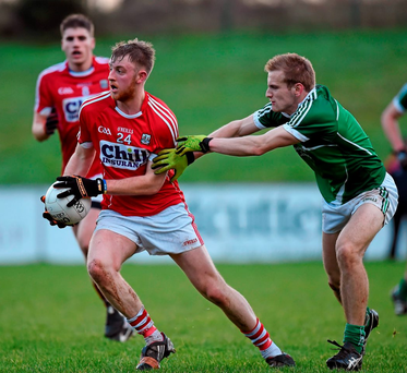 Cork's Killian O'Hanlon tries to pull away from Sean O'Dea, Limerick Photo: Brendan Moran / SPORTSFILE