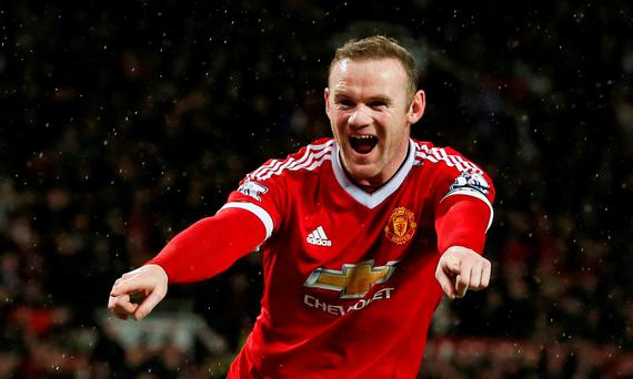 Wayne Rooney celebrates after scoring a wonder goal for Manchester United. Photo: Reuters / Andrew Yates