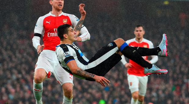 LONDON, ENGLAND - JANUARY 02: Aleksandar Mitrovic of Newcastle United attempts a bicycle kick during the Barclays Premier League match between Arsenal and Newcastle United at Emirates Stadium on January 2, 2016 in London, England. (Photo by Shaun Botterill/Getty Images)