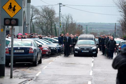 Team-mates and GAA officials form a guard of honour at the funeral of the late Kerry footballer Patrick Curtin at Moyvane Church, Co Kerry. Photo: Domnick Walsh