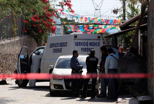 Police at the scene where Gisela Mota was shot dead. Photo: Reuters
