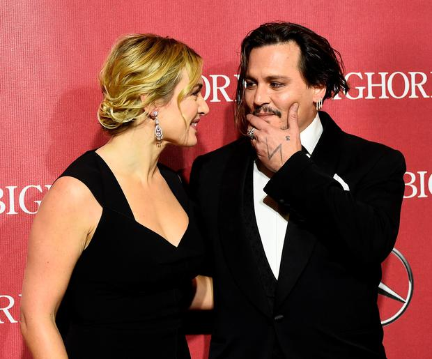 Actors Kate Winslet (L) and Johnny Depp attend the 27th Annual Palm Springs International Film Festival Awards Gala at Palm Springs Convention Center on January 2, 2016 in Palm Springs, California. (Photo by Frazer Harrison/Getty Images)