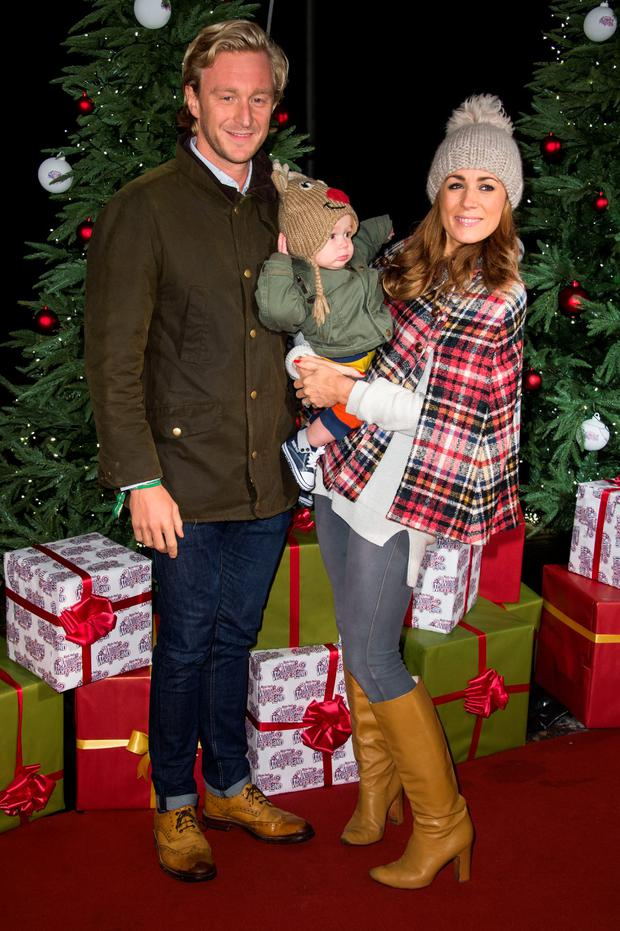 Owain Walbyoff, Natalie Pinkham and their son Wilfred attend the opening of Hyde Park's Winter Wonderland at Hyde Park on November 19, 2015 in London, England. (Photo by Ian Gavan/Getty Images)