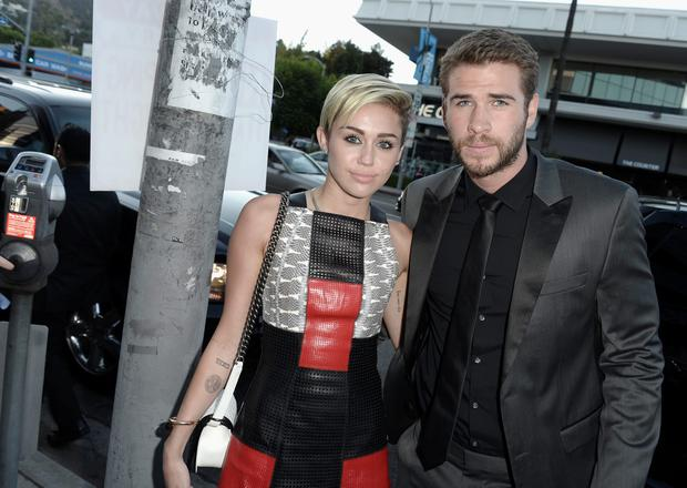 Miley Cyrus sports new diamond bling on wedding ring finger