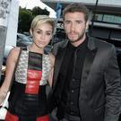 Actress Miley Cyrus and actor Liam Hemsworth attend the premiere of Relativity Media's