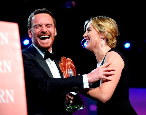 Actor Michael Fassbender (L) accepts the International Star Award from actress Kate Winslet onstage at the 27th Annual Palm Springs International Film Festival Film Festival Awards Gala at Palm Springs Convention Center on January 2, 2016 in Palm Springs, California. (Photo by Jason Merritt/Getty Images for PSIFF)