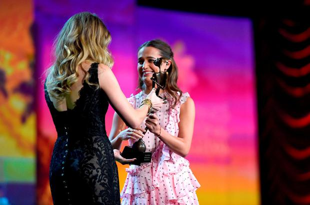 Actress Alicia Vikander (R) accepts the Rising Star Award from actress Amber Heard onstage at the 27th Annual Palm Springs International Film Festival Film Festival Awards Gala at Palm Springs Convention Center on January 2, 2016 in Palm Springs, California. (Photo by Jason Merritt/Getty Images for PSIFF)