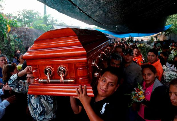 Residents and relatives carry the coffin of newly-installed Temixco mayor Gisela Mota from her home during her funeral in Temixco, south of Mexico City, after Mota was shot dead on Saturday by four armed gunmen, January 3, 2016