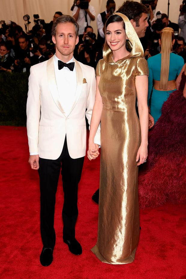 Adam Shulman (L) and Anne Hathaway attend the