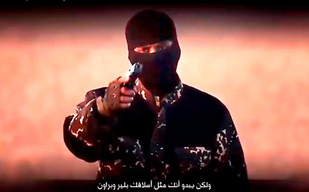 Screen grab taken from YouTube from undated footage issued by Islamic State militants showing a masked jihadi with a British accent mocking David Cameron in a purported new Islamic State video showing the execution of five men accused of being spies for the UK