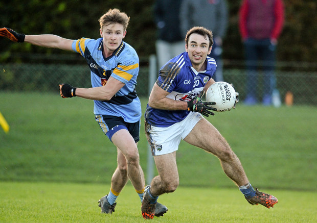 Gareth Dillon of Laois in action against UCD's Stephen Mulvany. Picture credit: Sam Barnes / SPORTSFILE