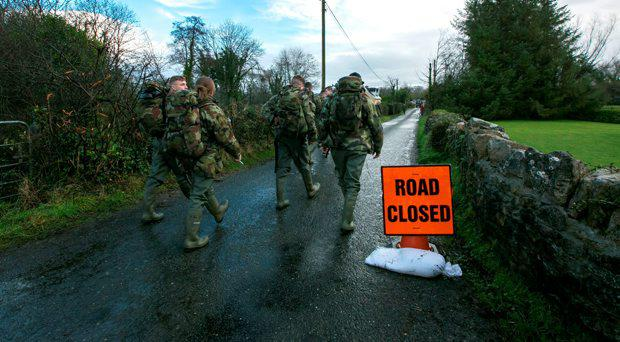 Army Personal making their way to help people get assess to Homes that are cut off by the flooding in Springfield Clonlara Co Clare