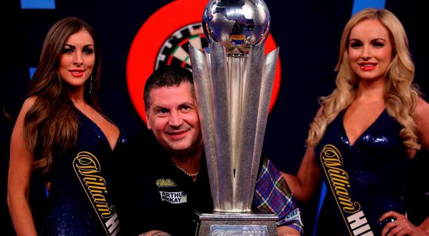 Gary Anderson celebrates with the Sid Waddell trophy