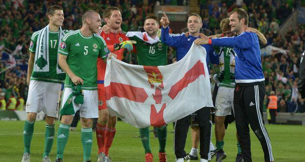 Northern Ireland players celebrate qualification for Euro 2016