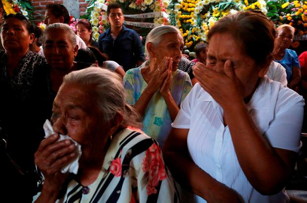 Residents react during the funeral of newly-installed Temixco mayor Gisela Mota in Temixco, south of Mexico City, after Mota was shot dead on Saturday by four armed gunmen