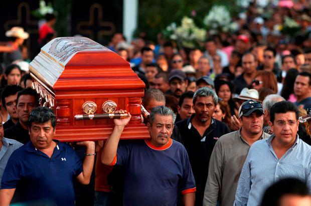 Residents and relatives carry the coffin of newly-installed Temixco mayor Gisela Mota along a street during her funeral in Temixco, south of Mexico City