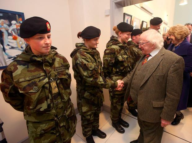 President Michael D higgins meets Private Stacey Kehoe as he visited flood damaged, Enniscorthy. co. Wexford. Picture credit; Damien Eagers