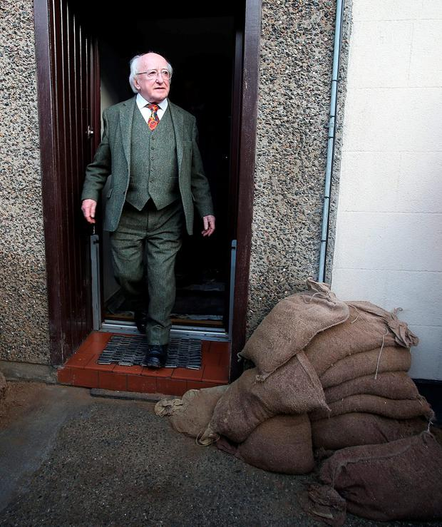 President Michael D Higgins visits flood damaged Enniscorthy. Co. Wexford. Picture credit; Damien Eagers