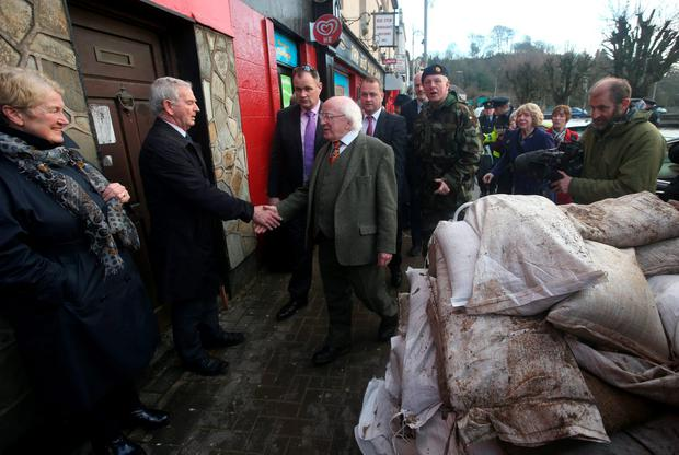 President Michael D Higgins shakes hands with local people as he visited flood damaged Enniscorthy. Co. Wexford. Picture credit; Damien Eagers