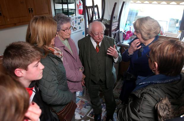 President Michael D Higgins and his wife Sabina speaks to Elizabeth O'Connor, 82, left, as he visited flood damaged, Enniscorthy. Co. Wexford. Picture credit; Damien Eagers