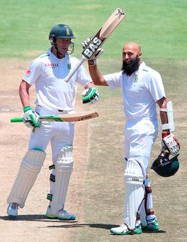 Hashim Amla, right, of the Proteas celebrates his century during day three of the second Test match between South Africa and England. Photo: Carl Fourie/Gallo Images/Getty Images